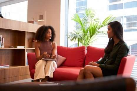 Two people conversing during Careers meeting